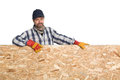 Smiling carpenter and plywood Royalty Free Stock Photos