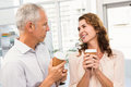 Smiling casual business colleagues having coffee together in the office Royalty Free Stock Photography