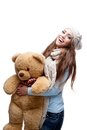 Smiling casual winter girl holding big soft toy Royalty Free Stock Photo