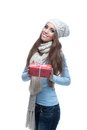 Smiling casual winter girl holding christmas gift Royalty Free Stock Image
