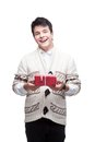 Smiling casual winter man holding christmas gift Stock Photo