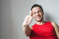 Smiling caucasian man shows thumbs up gesture positive young studio portrait Royalty Free Stock Photo