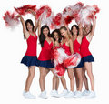 Smiling cheerleaders in red together on white Stock Image