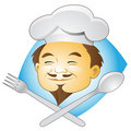 Smiling Chef with Cutlery Stock Photo