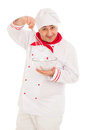 Smiling chef holding whisk and transparent bowl weraing red and white uniform over white background Royalty Free Stock Photography