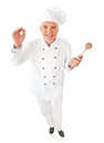 Smiling chef holding a wooden spoon Royalty Free Stock Photos