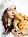 Smiling chef with italian bread woman Stock Photography