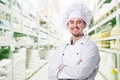 Smiling chef portrait and warehouse background Stock Image