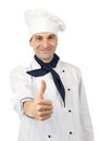 Smiling chef showing thumb up Stock Photography