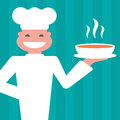 Smiling chef to serve a hot meal Stock Image