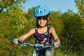 Smiling child on bicycle Royalty Free Stock Images