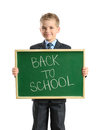 Smiling child with blackboard isolated on white background Stock Photo