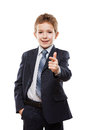 Smiling child boy in business suit index finger pointing directi Royalty Free Stock Photo