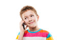 Smiling child boy talking mobile phone or smartphone Royalty Free Stock Photo