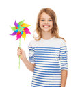 Smiling child with colorful windmill toy Royalty Free Stock Photo