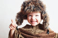 Smiling child in fur Hat.Kids casual winter style.fashion little funny boy.children emotion Royalty Free Stock Photo