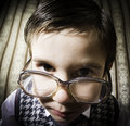 Smiling child with glasses in vintage clothes Royalty Free Stock Photo