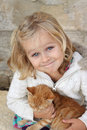 Smiling child with kitten Royalty Free Stock Photo