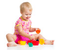 Smiling child playing with cup toys over white Stock Photos