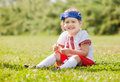 Smiling child in russian folk clothes on grass Royalty Free Stock Photo