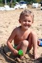 Smiling Child with Sand Shovel Stock Image