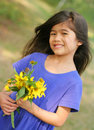 Smiling child with sunflowers Royalty Free Stock Photo