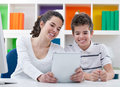 Smiling children with digital tablet at home Royalty Free Stock Photos