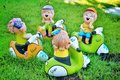 Smiling children garden decoration these pottery represent the happiness of your life Royalty Free Stock Images