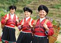 Smiling chinese minority woman yao group of happy women in traditional dresses outdoors Stock Photo