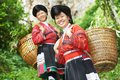 Smiling chinese minority woman yao group of happy women in traditional dresses outdoors Royalty Free Stock Image
