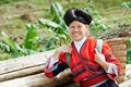 Smiling chinese minority woman yao happy in traditional dresses outdoors Stock Photos