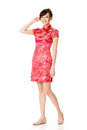 Smiling chinese woman dress traditional cheongsam at new year studio shot isolated on white background Royalty Free Stock Photography