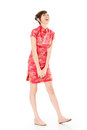 Smiling chinese woman dress traditional cheongsam at new year studio shot isolated on white background Stock Photos