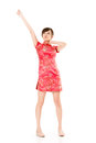Smiling chinese woman dress traditional cheongsam at new year studio shot isolated on white background Stock Photo