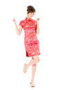Smiling chinese woman dress traditional cheongsam at new year studio shot isolated on white background Stock Image