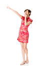 Smiling chinese woman dress traditional cheongsam at new year studio shot isolated on white background Stock Photography