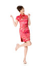 Smiling chinese woman dress traditional cheongsam at new year studio shot isolated on white background Stock Images