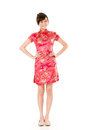 Smiling chinese woman dress traditional cheongsam at new year studio shot isolated on white background Royalty Free Stock Photo