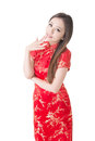 Smiling chinese woman dress traditional cheongsam at new year studio shot isolated on white background Royalty Free Stock Image