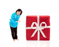 Smiling chinese woman offering huge gift on white background Royalty Free Stock Photos