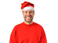 Smiling christmas man wearing a santa hat Stock Photos