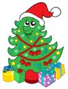Smiling Christmas tree with gifts Royalty Free Stock Image