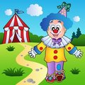 Smiling clown with circus tent Stock Photo