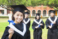 Smiling college graduate show a diploma Royalty Free Stock Photo