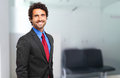 Smiling confident business man in his office businessman the Royalty Free Stock Photos