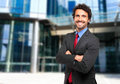 Smiling confident business man outdoor businessman with folded arms Stock Photography
