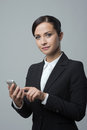 Smiling confident businesswoman using touch screen mobile phone business woman Royalty Free Stock Photography