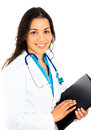 Smiling confident female doctor or nurse or healthcare professional holding patient chart Royalty Free Stock Photo