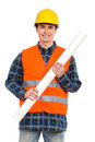 Smiling construction worker holding rolled paper plan. Royalty Free Stock Photo