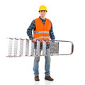 Smiling construction worker with ladder in yellow helmet and orange waistcoat full length studio shot isolated on white Stock Images
